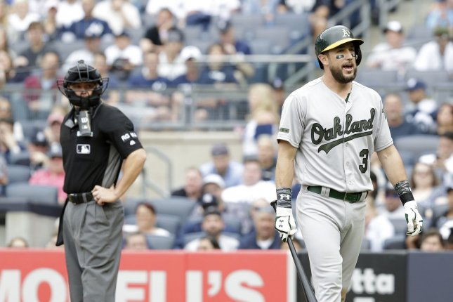 Former Oakland Athletics INF Trevor Plouffe reacts after striking out before being thrown out of the game by umpire Will Little in the 8th inning on May 27 at Yankee Stadium in New York City. Photo by John Angelillo/UPI