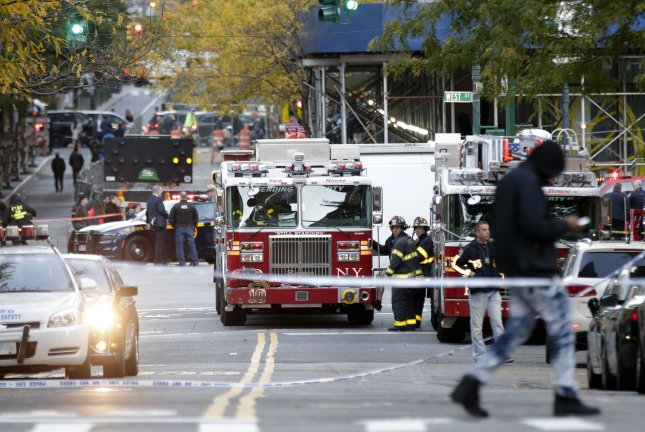 NYPD Police Officers and FDNY Firemen surround the area after a truck strikes pedestrians leaving 8 dead and about a dozen injured In Lower Manhattan on October 31, 2017 in New York City. Photo by John Angelillo/UPI