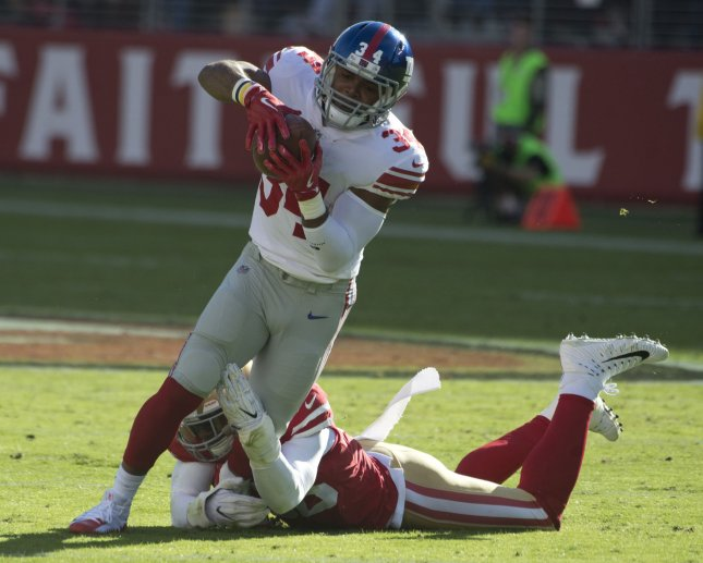 San Francisco 49ers linebacker Reuben Foster wraps up New York Giants running back Shane Vereen during a game in November. Photo by Terry Schmitt/UPI