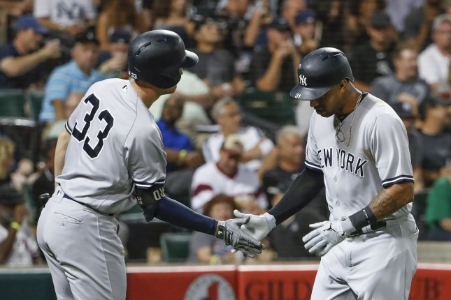 New York Yankees center fielder Aaron Hicks, right, celebrates with first baseman Greg Bird, left, after hitting a solo home run against the Chicago White Sox in the fifth inning on August 8 at Guaranteed Rate Field in Chicago. Photo by Kamil Krzaczynski/UPI