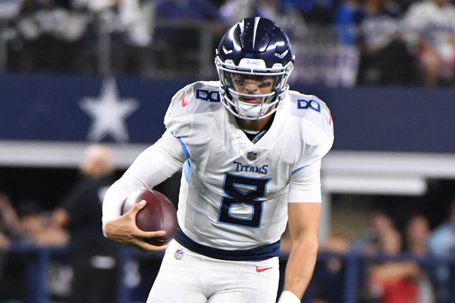 Tennessee Titans quarterback Marcus Mariota scrambles against the Dallas Cowboys during the first half on November 5, 2018 at AT&T Stadium in Arlington, Texas. Photo by Ian Halperin/UPI