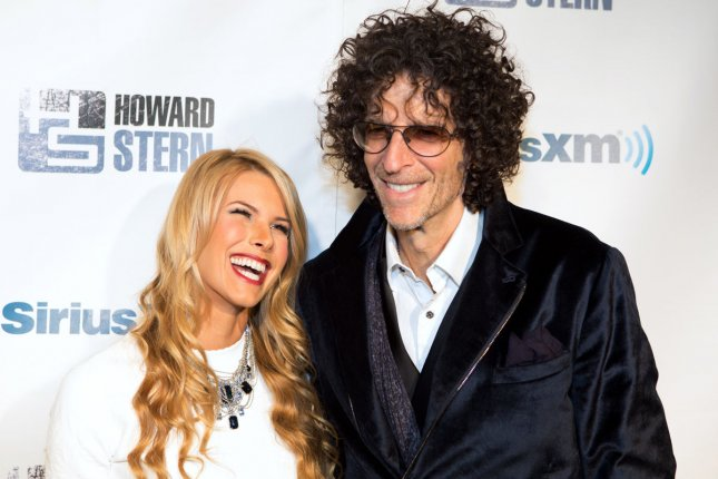 Howard Stern (R) with his wife Beth Stern. The radio host said on The Tonight Show that he regrets his interview with Robin Williams. File Photo by Justin Alt/UPI