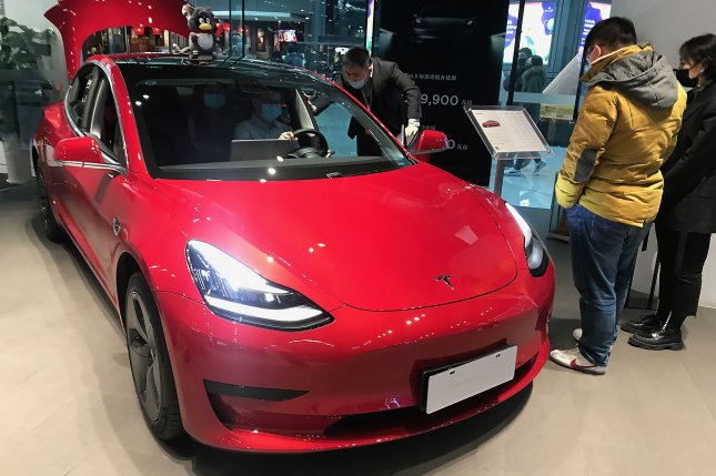 Chinese customers check out a Tesla Model 3 at a showroom in Beijing on November 28, 2020. Tesla electric car rival Xpeng said Monday it is pricing its P5 sedan cheaper than Model 3. File Photo by Stephen Shaver/UPI