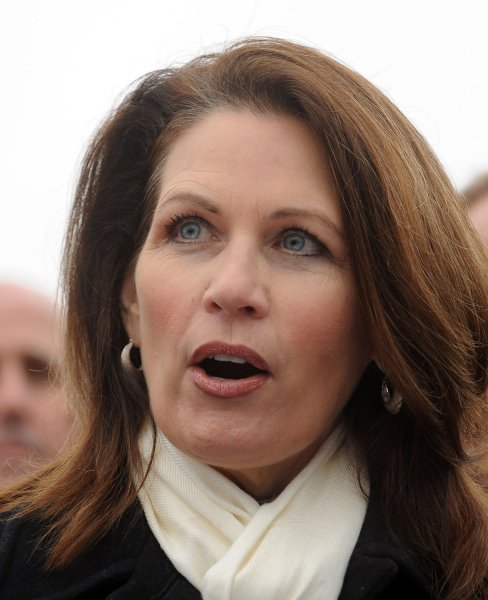 Rep. Michele Bachmann, R-MN, backed by activists and Members of Congress, speaks during a news conference after receiving petitions to call for the repeal of last year's health care legislation on Capitol Hill in Washington on January 18, 2011. Tomorrow the Republican-lead House of Representatives will vote on repealing the legislation. UPI/Roger L. Wollenberg