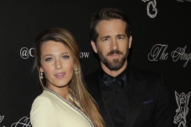 Ryan Reynolds (R) and wife Blake Lively at the Gabrielle's Angel Foundation annual Angel Ball on October 20, 2014. The actor will reprise Deadpool in a new standalone film. File photo by John Angelillo/UPI
