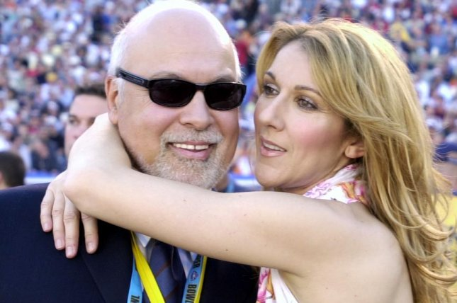 Singer Celine Dion hugs husband Rene Angelil before performing during pre-game ceremonies at Super Bowl XXXVII, on Jan. 26, 2003 in San Diego Photo by Earl Cryer/UPI
