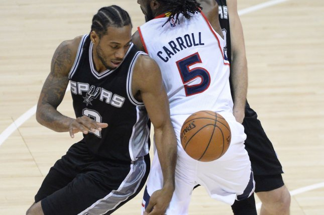 San Antonio Spurs' Kawhi Leonard (L). Photo by David Tulis/UPI