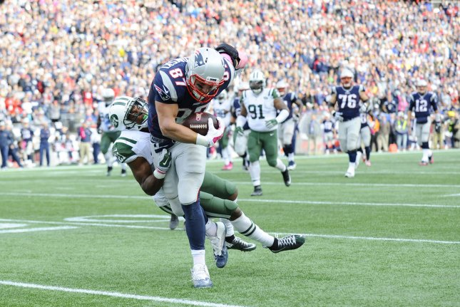 New England Patriots tight end Rob Gronkowski (87) is tackled by former New York Jets free safety Marcus Gilchrist (21) on a reception in the fourth quarter at Gillette Stadium in Foxborough, Massachusetts on October 25, 2015. File photo by Matthew Healey/UPI
