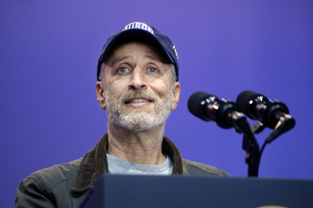 Jon Stewart introduces Vice President Joe Biden at the kick off of the 5th anniversary of Joining Forces and the 75th anniversary of the USO at Joint Base Andrews on May 5. An animated project from Stewart that would have aired on HBO has been canceled. Pool Photo by Olivier Douliery/UPI