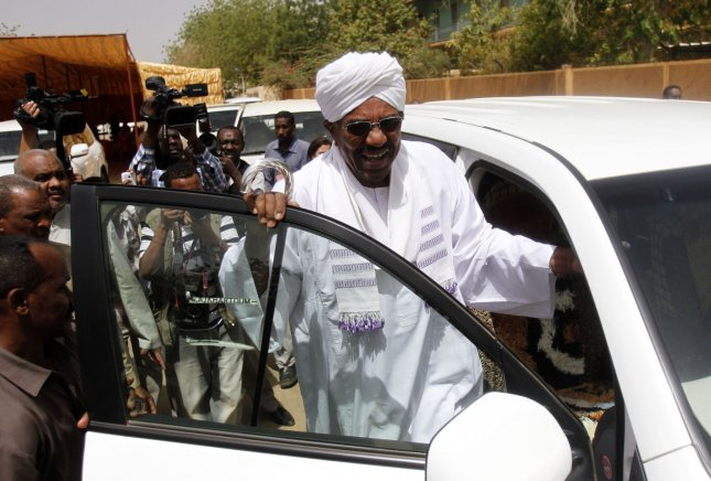 Sudanese President and candidate in the presidential elections Omar al-Bashir arrives at a polling station to cast his vote at the Saint Francis school in the capital, Khartoum, on April 13, 2015. The United States permanently lifted sanctions economic sanctions against Sudan on Friday. File Photo by Abderaouf Ubgadar/UPI