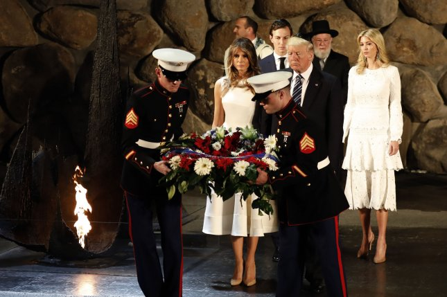 President Donald Trump attends a wreath-laying ceremony during a visit to the Yad Vashem Holocaust Memorial museum in Jerusalem, Israel, on May 23, 2017 with White House senior adviser Jared Kushner (back L), Ivanka Trump (back-R), First Lady Melania Trump (middle-L) and Rabbi Yisrael Meir Lau (back-C). Pool photo by Gali Tibbon/UPI