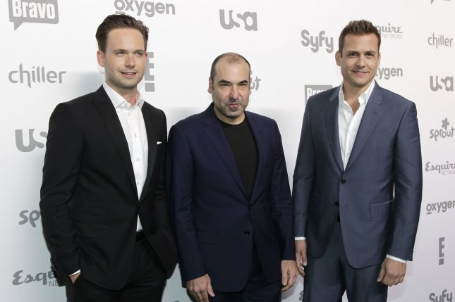 Patrick J. Adams (L), pictured with Rick Hoffman (C) and Gabriel Macht, will leave Suits after Season 7. File Photo by John Angelillo/UPI