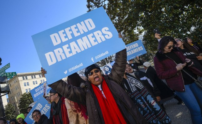 A demonstrator holds a Defend Dreamers sign during the 45th Annual March for Life, and as the government faces a shutdown, in Washington, D.C., on January 19, 2018. The House passed a bill that would provide a path to citizenship for DACA recipients Tuesday.  File Photo by Leigh Vogel/UPI
