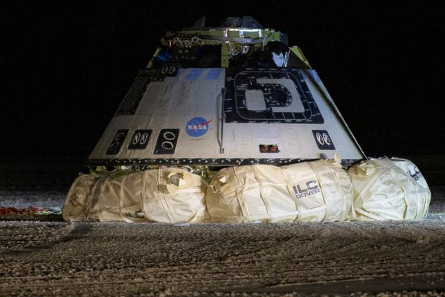 The Boeing CST-100 Starliner spacecraft is seen after it landed in White Sands, N.M., on Dec. 22. NASA Photo by Bill Ingalls/UPI