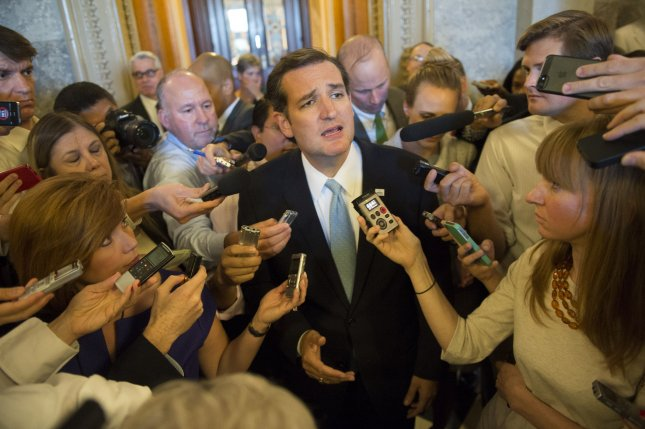 Sen. Ted Cruz (D-TX) speaks to the media after ending his nearly day-long filibuster like speech on Capitol Hill in Washington, D.C. on September 25, 2013. Cruz, who took the floor yesterday afternoon spoke for almost 21 hours straight, making his speech the fourth-longest filibuster in Senate history. The Senate is scheduled to vote today on the House's continuing resolution that is also tied to defunding Obamacare. UPI/Kevin Dietsch