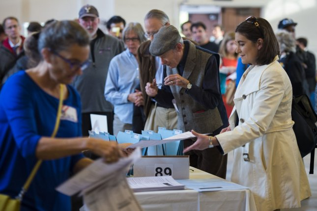 People line up to vote at Eastern Market in Washington, DC, Nov. 4, 2014. Voters across the country will cast ballots on several hot-button issues that have the potential to drive voter turnout in some of the closest races. UPI/Molly Riley