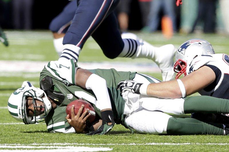 New England Patriots defensive tackle Chris Jones sacks Geno Smith on Oct. 20, 2013. File photo by John Angelillo/UPI