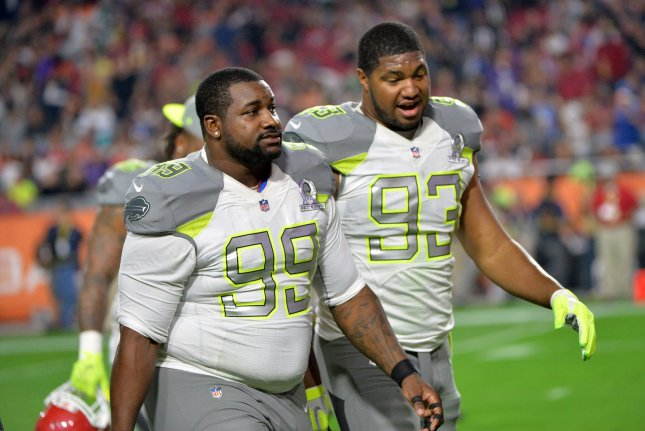 Buffalo Bills' Marcell Dareus (99) and Arizona Cardinals Calais Campbell leave the field together during the Pro Bowl at University of Phoenix Stadium in Glendale, Arizona on January 24, 2015. Photo byKevin Dietsch/UPI
