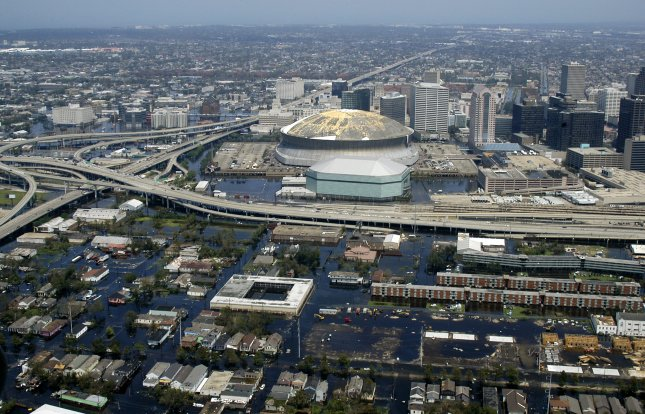 Aerial view from a U.S. Navy helicopter shows the rising flood waters threatening the entire downtown New Orleans city center, including the famed Superdome on August 31, 2005. Interstate 10 runs to the top of the photograph heading east and Route 90 runs horizontal to connect to New Orleans' West Bank across the Mississippi River. Photo by Jeremy L. Grisham/U.S. Navy/UPI