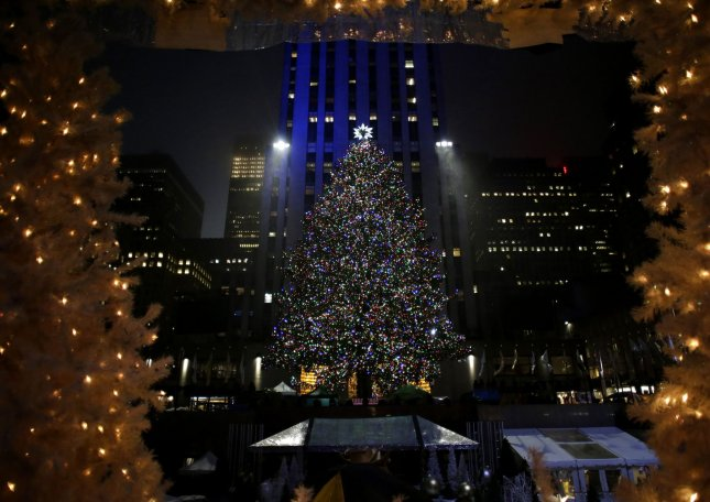 The Christmas Tree is lit for the first time at the annual Christmas Tree Lighting Ceremony at Rockefeller Center in New York City on November 30. Thousands of revelers crowded the sidewalks for the event. The tree will remain lit and can be viewed until 9 p.m. on January 7, 2017. Photo by John Angelillo/UPI