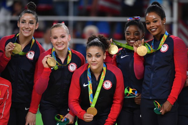 American gymnasts Aly Raisman, Madison Kocian, Lauren Hernandez, Simone Biles and Gabby Douglas (L-R) celebrate their team gold medal at the Olympics in Rio de Janeiro, Brazil, in August. More than 80 gymnasts have accused a former doctor for the national team of sexual abuse. File Photo by Kevin Dietsch/UPI