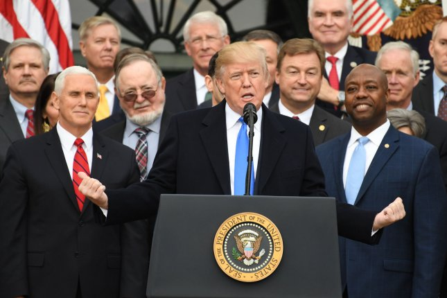 President Donald Trump delivers remarks on the passage of the Republican tax bill on Wednesday at the White House. Photo by Pat Benic/UPI