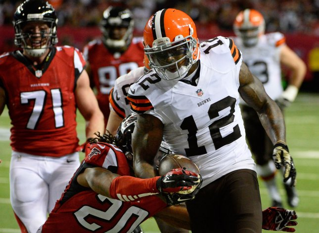 Cleveland Browns receiver Josh Gordon (12) drives for extra yardage against Atlanta Falcons safety Dwight Lowery (20) during the first half of their NFL game at the Georgia Dome in Atlanta on November 23, 2014.Photo by David Tulis/UPI