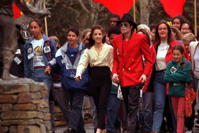 Lisa Marie Presley and Michael Jackson pictured walking hand-in-hand as they hosted youngsters at Jackson's Neverland Ranch in Santa Ynez, Ca. File photo by Jim Ruymen/UPI