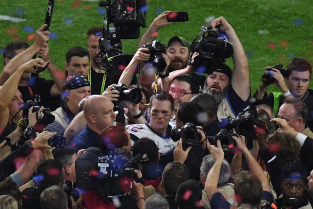 New England Patriots quarterback and Super Bowl MVP Tom Brady shows his emotions surrounded by media at Super Bowl LI at NRG Stadium in Houston, Texas on February 5, 2017. New England beat Atlanta 34-28 in NFL's first Super Bowl overtime game. Photo by Jon SooHoo/UPI