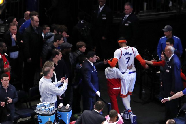 New York Knicks Carmelo Anthony walks off the court after the game in what is likely the final game Anthony played in a Knicks uniform. File photo by John Angelillo/UPI
