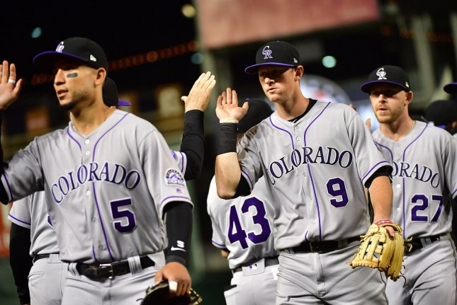 Colorado Rockies second baseman DJ LeMahieu (9) celebrates with teammates after the Rockies defeated the Washington Nationals 5-1 on April 12 at Nationals Park in Washington, D.C. Photo by Kevin Dietsch/UPI