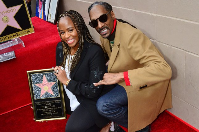 Snoop Dogg is joined by his wife, Shante Broadus, during an unveiling ceremony honoring him with the 2,651st star on the Hollywood Walk of Fame in Los Angeles on Monday. Photo by Jim Ruymen/UPI