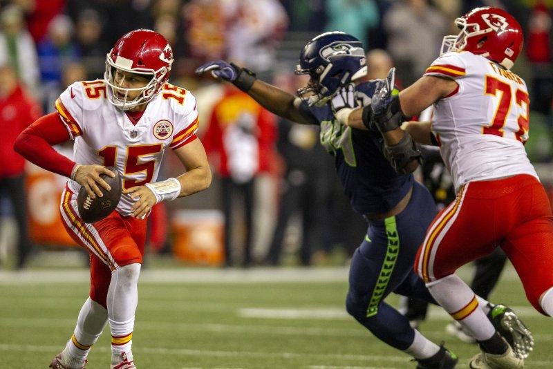 Kansas City Chiefs quarterback Patrick Mahomes (15) scrambles against the Seattle Seahawks during the third quarter on Sunday night at CenturyLink Field in Seattle, Washington. Photo by Jim Bryant/UPI