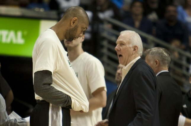 San Antonio Spurs head coach Gregg Popovich (R) coached Tim Duncan (L), who leads the franchise in points, rebounds and blocks, for 19 seasons before his retirement in 2016. File Photo by Gary C. Caskey/UPI