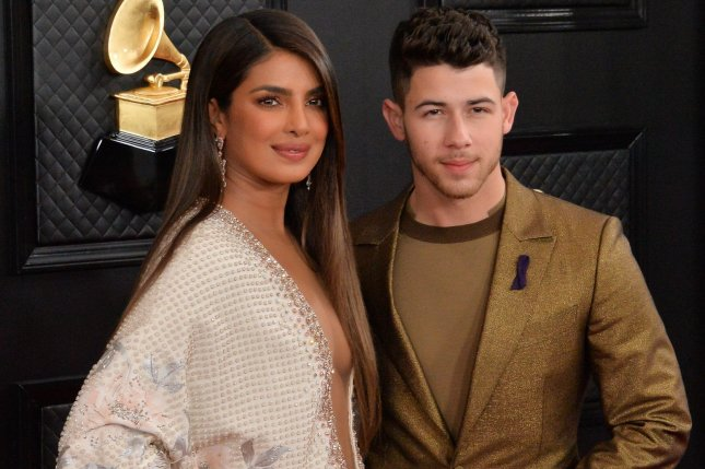Nick Jonas (R) and his wife Priyanka Chopra arrive for the 62nd annual Grammy Award on January 26. Jonas will be starring in upcoming action film The Blacksmith with Laurence Fishburne. File Photo by Jim Ruymen/UPI