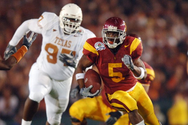USC Trojans tailback Reggie Bush (5) runs with the ball against the Texas Longhorns at the Rose Bowl Game in Pasadena, Calif., on January 4, 2004. File Photo by Michael Tweed/UPI