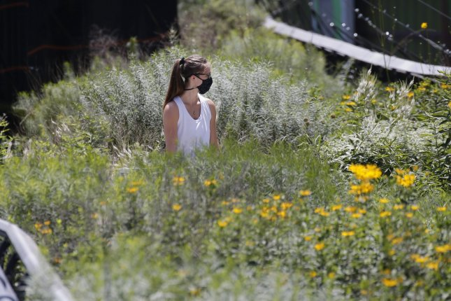 People walk through the High Line park Thursday in New York City. New York state has been on a downward trajectory in its number of new coronavirus cases and deaths. Photo by John Angelillo/UPI
