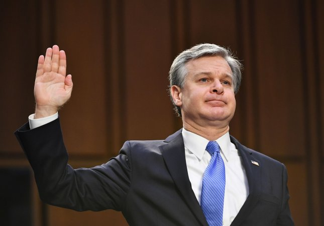 Federal Bureau of Investigation Director Christopher Wray is sworn in Tuesday to testify before a Senate Judiciary Committee looking into the January 6th insurrection, domestic terrorism and other threats, on Capitol Hill in Washington, D.C. Pool Photo by Mandel Ngan/UPI