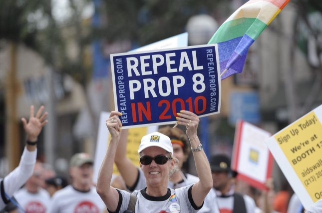 Same sex marriage supporters carry signs opposing Prop 8 during the 2009 LA Pride Parade in West Hollywood, California on June 14, 2009. (UPI Photo/Phil McCarten)