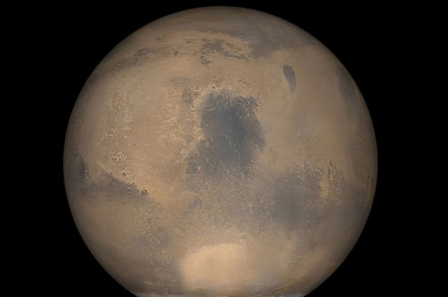 This image of Mars was taken by NASA's Mars Reconnaissance Orbiter on approach to the red planet plane. (UPI Photo/NASA)