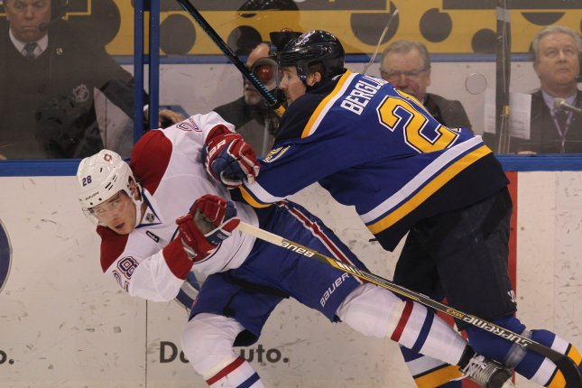 St. Louis Blues' Patrik Berglund knocks Montreal Canadiens defenseman Nathan Beaulieu off of the puck in the first period at the Scottrade Center in St. Louis. File photo by Bill Greenblatt/UPI