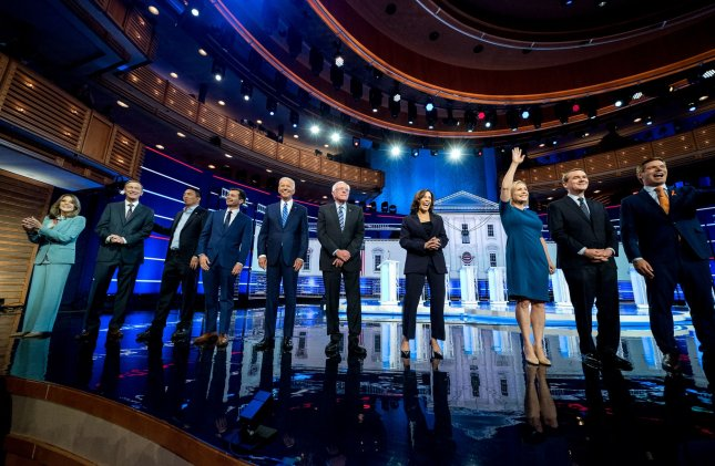 Democratic presidential primary candidates are introduced prior to the NBC, MSNBC, Telemundo Democratic Debate at the Knight Concert Hall in Miami on Thursday. Photo by Kevin Dietsch/UPI