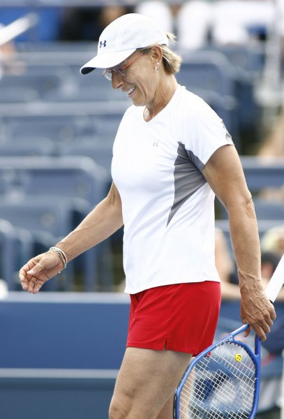 Martina Navratilova of the U.S.A smiles after missing the ball as she takes on Jana Novotna of the Czech Republic during their Champions game at U.S. Open tennis championship at the U.S. National Tennis Center on September 3, 2008 in Flushing Meadows, New York. Navratilova won 6-4, 6-2. (UPI Photo/Monika Graff)