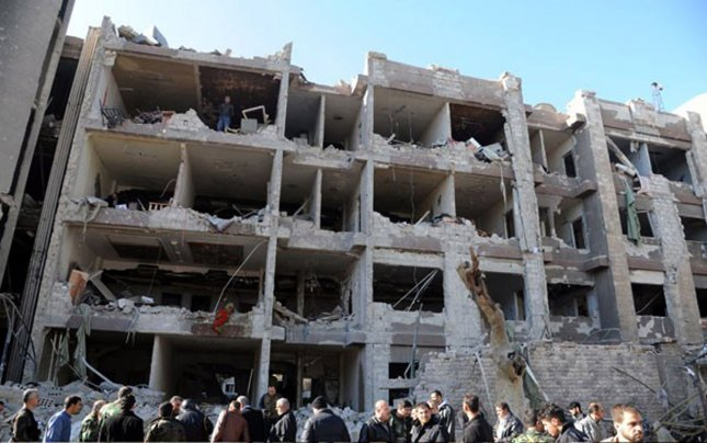 In a handout photograph released by the Syrian Arab News Agency (SANA), Syrian security officers inspect the site of bomb blast in Damascus, Syria on March 17, 2012. Syrian health ministry officials said that at least 27 people were killed and 97 injured in twin explosions that hit the Syrian capital Damascus, Syrian television said. UPI