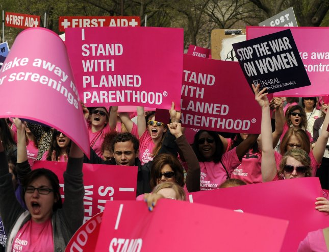 Demonstrators hold signs during a pro-choice rally in Washington on April 7, 2011. Republican budget proposals would cut off funding to Planned Parenthood which provides abortion services in addition to other women's health services like family planning and cancer screening. UPI/Roger L. Wollenberg