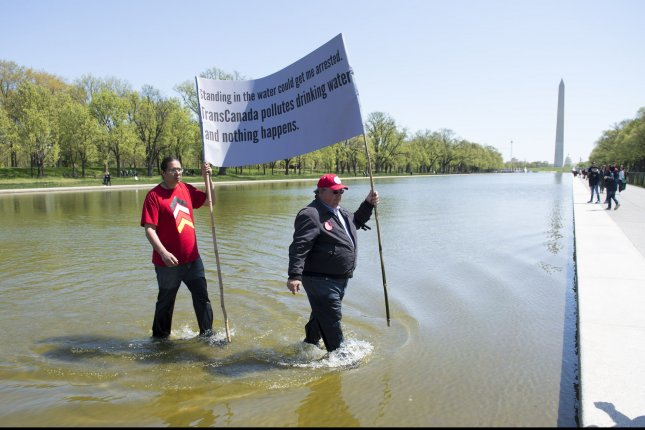 Wizipan Little Elk (L) and Art Tanderup, members of the Cowboy and Indian Alliance participate in a a protest against the KXL pipeline at the Reflecting Pool on the Nationals Mall in Washington, D.C. on April 24, 2014. The Cowboy and Indian Alliance organized the Keystone XL tar sands pipeline protest to show the need to highlight the possible environmental impacts of the project. UPI/Kevin Dietsch