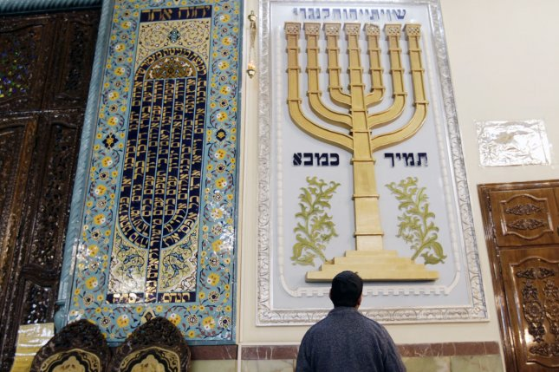An Iranian Jewish man prays during Hanukkah celebrations in a Tehran Synagogue on on December 26, 2011, in Tehran, Iran. (UPI/Maryam Rahmanian)
