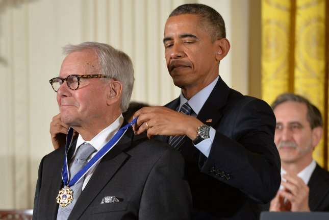 President Barack Obama awards journalist Tom Brokaw a Presidential Medal of Freedom during a ceremony at the White House in Washington, D.C. on November 24, 2014. UPI/Kevin Dietsch