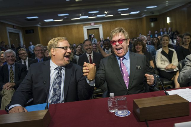 Entertainer and AIDS advocate Sir Elton John, right, greets Pastor Rick Warren during a Senate appropriations subcommittee hearing on funding for global health programs on Capitol Hill in Washington, D.C., on Wednesday. Photo by Kevin Dietsch/UPI