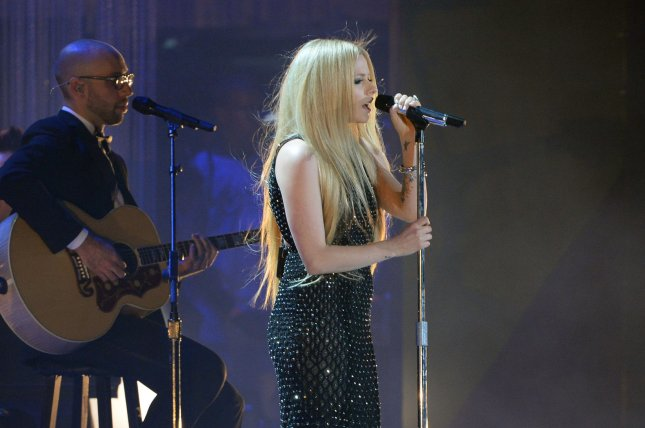 Avril Lavigne performs during the opening ceremony of the Special Olympics World Games at the Los Angeles Memorial Coliseum in Los Angeles on July 25, 2015. It was her first performance since revealing she's been battling Lyme disease. Photo by Jim Ruymen/UPI